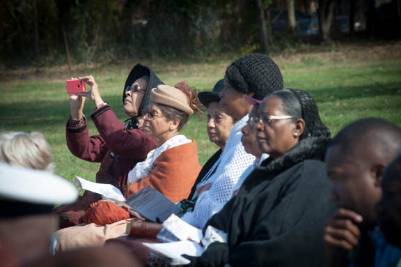 Members of FREED (Female Reenactors of Distinction of the American Civil War): take a cellphone photograph during the Veterans Remembrance Ceremony at Saint Elizabeths Hospital East Campus. Photo by Susana Raab/Anacostia Community Museum/Smithsonian Institution