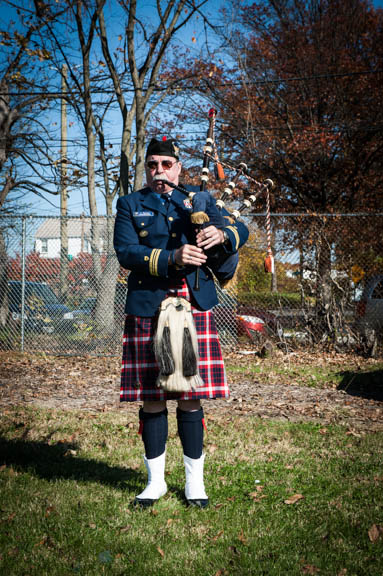 -Jeffrey Burton of the US Coast Guard Pipe Band plays during the Veterans Remembrance Ceremony at Saint Elizabeths Hospital East Campus.   Photo by Susana Raab/Anacostia Community Museum/Smithsonian Institution