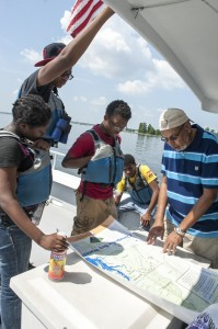 Image- From left to right. Crystal Sandoval, Nnamdi Anomnachi, Kofi Henderson, Mike Brown, and Tony Thomas explore the Potomac River on the Chesapeake Bay Foundation's Susquehanna. Susana Raab ACM