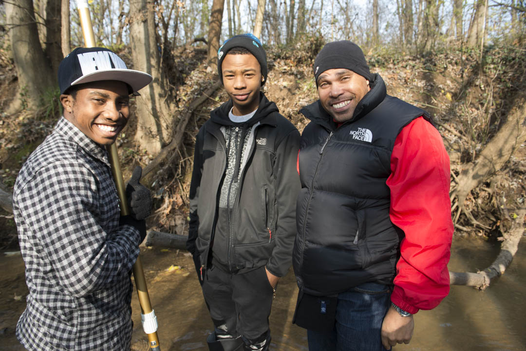 Dwayne Redd, of State Farm, right, poses with David McIntyre of Ballou High School and Anthony Lawson of Ideal Charter School, during the visit to Lower Beaverdam Creek. Photo by Susana Raab/Anacostia Community Museum/Smithsonian Institution
