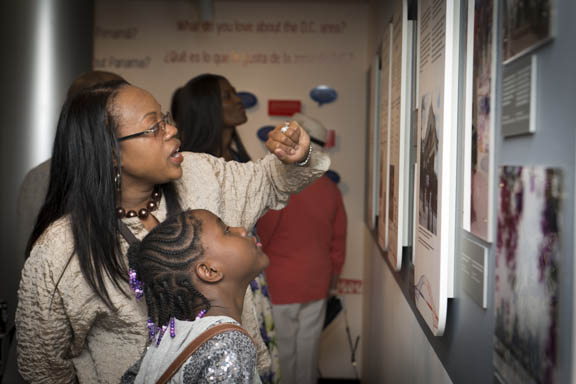 "April 12, 2015 - Attendees at the opening of the exhibit, ""Bridging the Americas"" in the Anacostia Community Museum program room curated by Dr. Ariana Curtis. Photo by Susana Raab/Anacostia Community Museum/Smithsonian Institution"