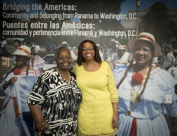 "Aunt  Carol Richardson poses with Curator Ariana Curtis, Ph.D. at the opening of the exhibit, ""Bridging the Americas"" in the Anacostia Community Museum program room curated by Dr. Ariana Curtis. Photo by Susana Raab/Anacostia Community Museum/Smithsonian Institution"