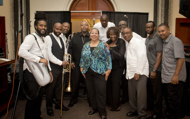 June 12, 2015 -Director Camille Akeju poses with members of Phase II the band during the Anacostia Community Museum annual soiree held at the Smithsonian Castle on the Mall. Photo by Susana Raab/Anacostia Community Museum/Smithsonian Institution
