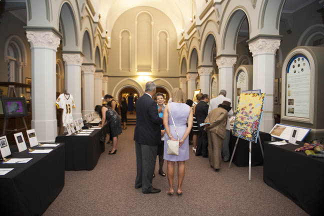 June 12, 2015 - MIstress of Ceremonies Maureen Bunyan chats with guests in teh silent auction area of the Anacostia Community Museum annual soiree held at the Smithsonian Castle on the Mall. Photo by Susana Raab/Anacostia Community Museum/Smithsonian Institution