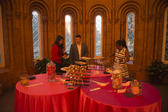 June 12, 2015 -The Commons area of the Smithsonian Castle houses cases of artifacts from many of the Smithsonian's museums and research center, and served as a dessert area at the Anacostia Community Museum annual soiree held at the Smithsonian Castle on the Mall. Photo by Susana Raab/Anacostia Community Museum/Smithsonian Institution