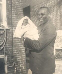 Percival Bryant holding a baby, circa 1951. Percival Bryant Collection, Smithsonian Anacostia Community Museum Archives