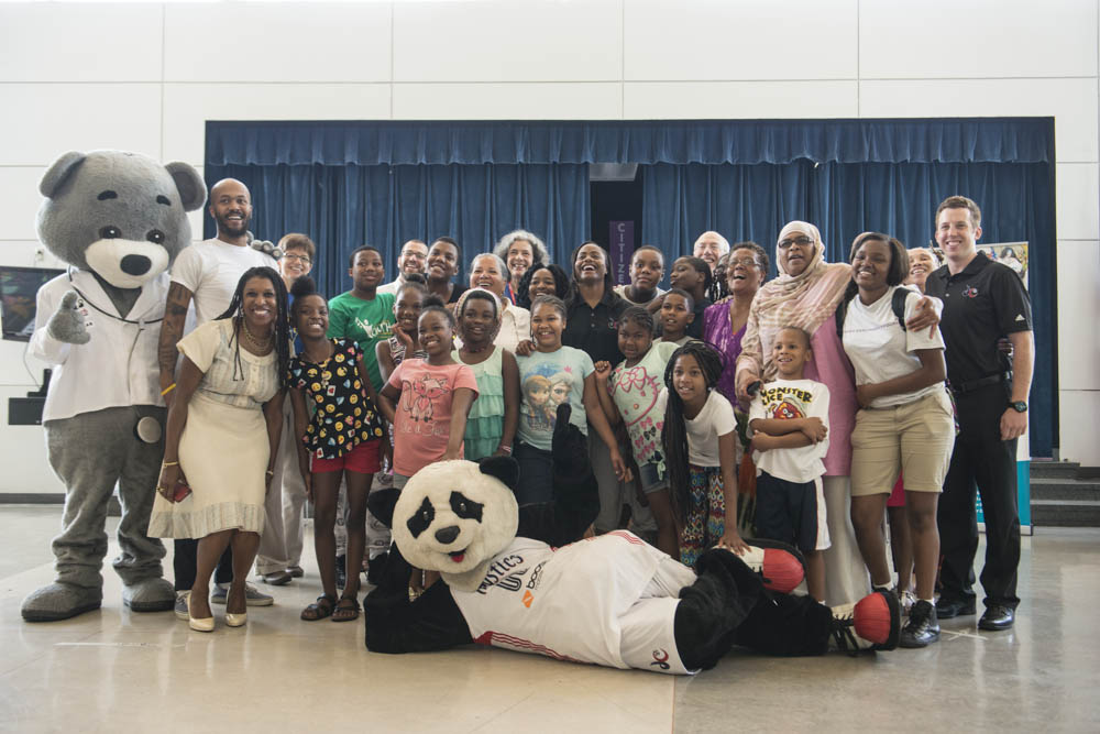 June 29, 2015 - A group photograph at Savoy Elementary School in SE Washington for a joint event announcing the launch of a health and wellness partnership between the Childrens' National Health System, Monumental Sports, and the Smithsonian Anacostia Museum. Photo by Susana Raab/Anacostia Community Museum/Smithsonian Institution