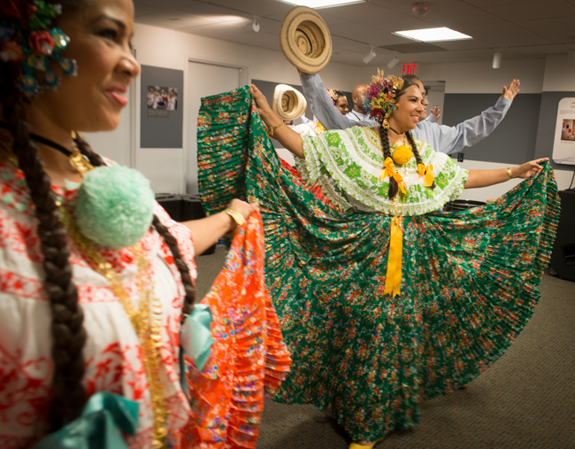 The polleras, the colorful dresses worn by Panamanian dancers brightened up a rainy day.