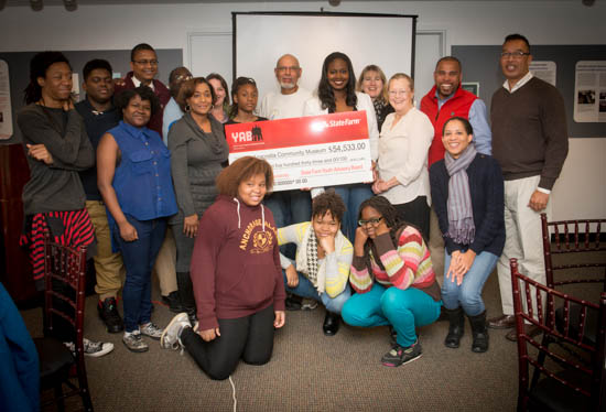 October 31, 2015- State Farm Representative Angela Rosser and Dwayne Redd  poses with members of the Anacostia Community Museum, student's in the museum's Citizen Scientist Program during a ceremony honoring State Farm's Youth Advisory Board's funding of the Anacostia Community Museum Citizen Scientist Program. Susana Raab/Anacostia Community Museum/Smithsonian Institution