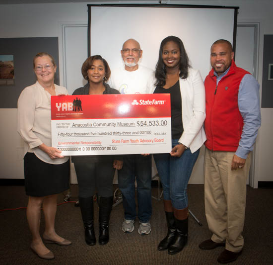 October 31, 2015- Anacostia Community Museum Deputy Director Sharon Reinckens poses with State Farm Representative Angela Rosser, Tony Thomas, Anacostia Community Museum Citizen Scientist Program Manager, Anacostia Community Museum Director of Development Tykia Warden, and Dwayne Redd of State Farm's Youth Advisory Board during a ceremony honoring State Farm's Youth Advisory Board's funding of the Anacostia Community Museum Citizen Scientist Program. Susana Raab/Anacostia Community Museum/Smithsonian Institution