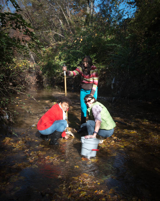 October 31, 2015- Students M'Kya Denny and Iyona Whitehead of the Anacostia Community Museum's Citizen scientist program with teacher Allison Cawood during an outing to a tributary of the Anacostia Watershed near Kennilworth Park in support of the Anacostia Community Museum's Citizen Scientist Program which received support from State Farm. Susana Raab/Anacostia Community Museum/Smithsonian Institution