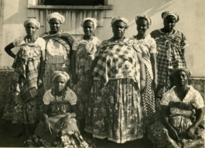 From left to right Hilda of Oxum; Celina of Oxalufan; Carmen, daughter of Mae Menininha and leader of the Gantois today; Mae Menininha; Cleusa, oldest daughter of Mae Meninha and her successor in the leadership of the Gantois; America of Obaluae Kneeling in front: Floripedes of Oxossi; and Titia Amor of Obalue
