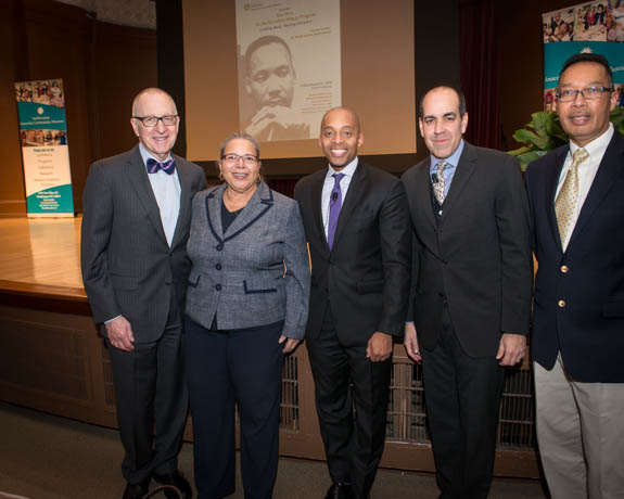 January 15, 2016 - Smithsonian Secretary David J. Skorton, Anacostia Community Museum Director Camille Akeju, Dr. Khalil Gibran Muhammad, Richard Reyes-Gavilan, and Paul Perry pose for a photograph prior to the commencement of the annual Martin Luther King Jr. Celebration event. Photo by Susana Raab/Anacostia Community Museum/Smithsonian Institution