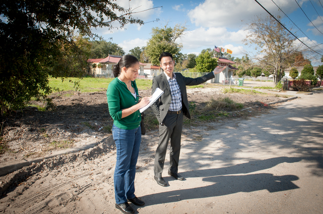 December 7, 2015 - Biloxi, Mississippi - Anacostia Community Museum Researcher Katrina Lashley and local Miceky Sou explore the neighborhood where the Vietnamese Catholic Church on Oak St. in Biloxi Mississippi sits next door to the Buddhist temple. Photo by Susana Raab/Anacostia Community Museum/Smithsonian Institution