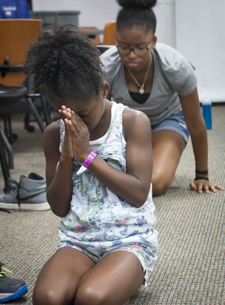 July 17, 2016 - Members of the Museum Academy practice yoga in the Anacostia Community Museum program room during summer break. Susana Raab/Anacostia Community Museum/Smithsonian Institution