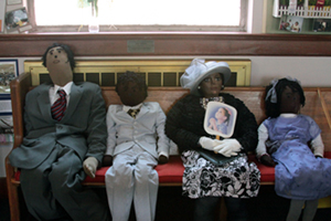 Soft sculptures on a pew at Matthews Memorial Baptist Church. Photograph by Chimere Becote/ACM.